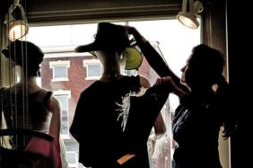 Employee Cathy Perkins tried hats on a mannequin in the window of Alter Ego in NuLu.Photo by Ron Bath
